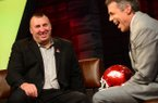 Arkansas coach Bret Bielema (left) shares a laugh with ESPN anchor Chris Fowler on Tuesday at ESPN headquarters in Bristol, Conn.