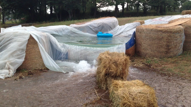 Hay bale pool photo gallery - Redneck swimming pool with hay bales ...