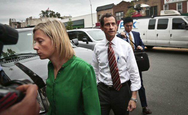 anthony-weiner-center-new-york-mayoral-candidate-arrives-with-aides-at-a-campaign-stop-on-thursday-july-25-2013-in-new-york