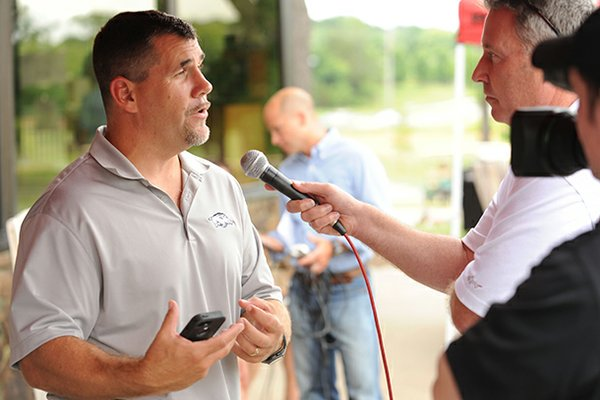 Arkansas defensive line coach Charlie Partridge, left, speaks Thursday, July 25, 2013, at Paradise Valley Athletic Club in Fayetteville.