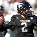 Texas A&M quarterback Johnny Manziel (2) looks for an open receiver during the first quarter of an N...