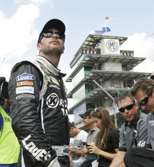 Sprint Cup Series driver Jimmie Johnson watches during qualifications for the Brickyard 400 auto race at the Indianapolis Motor Speedway in Indianapolis, Saturday, July 27, 2013. (AP Photo/AJ Mast)