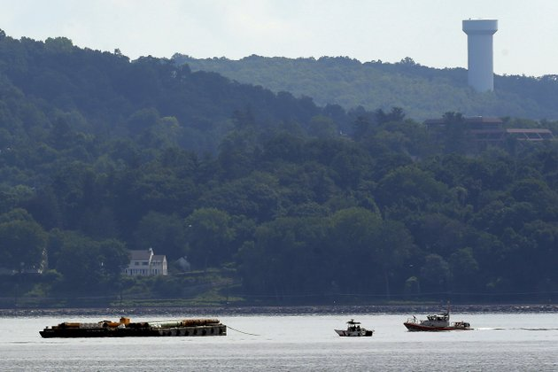 rescue-workers-on-boats-search-near-a-construction-barge-left-on-the-hudson-river-in-piermont-ny-on-saturday-july-27-2013-south-of-the-tappan-zee-bridge-after-two-people-fell-into-the-water-during-a-boat-crash-one-remained-missing-sunday-after-workers-found-the-body-of-a-woman-saturday