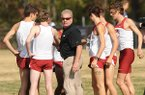 Arkansas coach Chris Bucknam gathers his team together Friday, Nov. 9, 2012, prior to the start of the NCAA South Central Regional meet at the UA's Agri Park in Fayetteville.