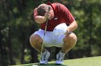 Sebastian Cappelen of Fayetteville wipes his forehead Thursday afternoon during the third round of the Western Amateur Championship at the Alotian Club.