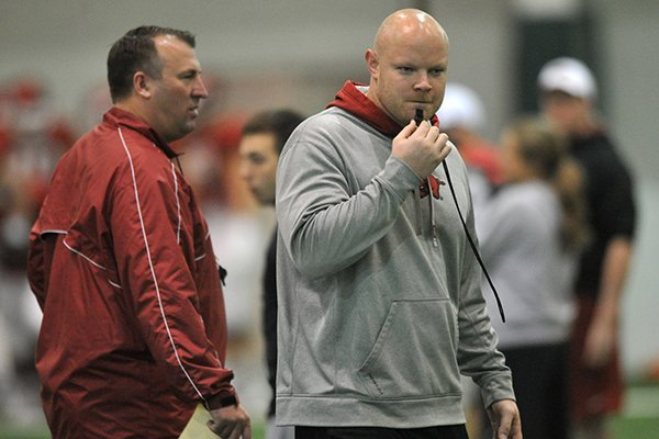 Arkansas Head Strength and Conditioning Coach Ben Herbert works with the Razorbacks during practice Saturday March 30, 2013 in Fayetteville.