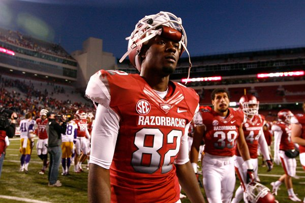 Mekale McKay leaves the field following Arkansas' 20-13 loss to LSU on Nov. 23, 2012 at Donald W. Reynolds Razorback Stadium in Fayetteville.