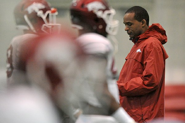 Arkansas linebackers coach Randy Shannon watches during a spring practice in Fayetteville.