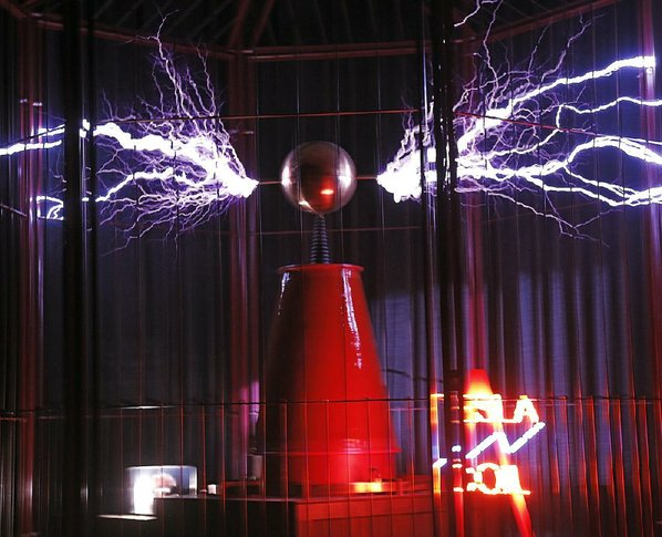 Electrifying invention nwadg john sykes jr the tesla coil at mid america science museum in hot springs emits a crackling web of electrical energy snapping at the bars of its cage sciox Gallery