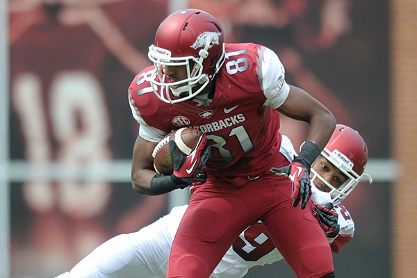 Arkansas receiver Demetrius Wilson brakes a tackle during the Razorbacks' Red-White Game on April 20, 2013 in Fayetteville.