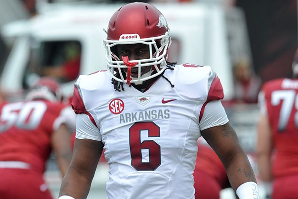 Arkansas defensive end Jamichael Winston warms up prior to the Razorbacks' Red-White Game on April 20, 2013 in Fayetteville.