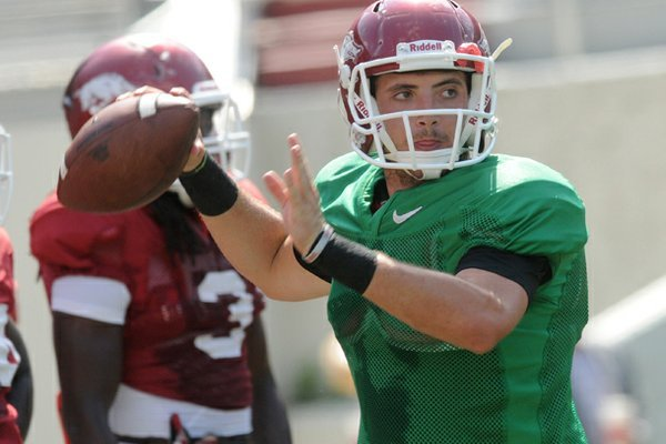 Arkansas quarterback Brandon Allen warms up before a scrimmage Saturday at Donald W. Reynolds Razorback Stadium in Fayetteville.