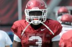 Arkansas running back Alex Collins runs drills before a scrimmage Saturday at Razorback Stadium in Fayetteville.