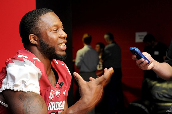 University of Arkansas senior fullback Kiero Small answers questions during the school's media day Sunday, Aug. 11, 2013 at the Fred W. Smith Football Center in Fayetteville.