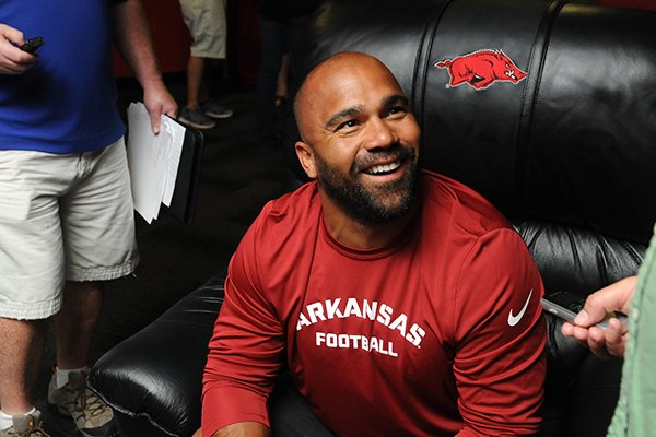 Arkansas running backs coach Joel Thomas speaks during Arkansas' media day Aug. 11, 2013 in Fayetteville.