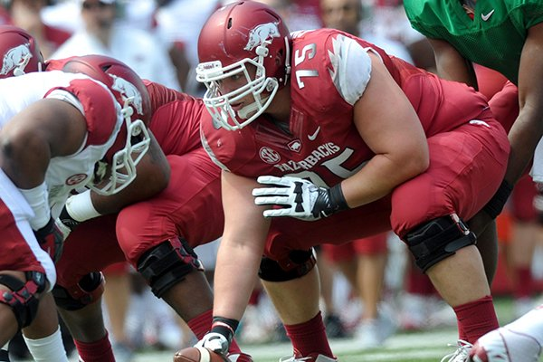 Arkansas center Luke Charpentier lines up during the Razorbacks' Red-White Game on April 20, 2013 in Fayetteville.
