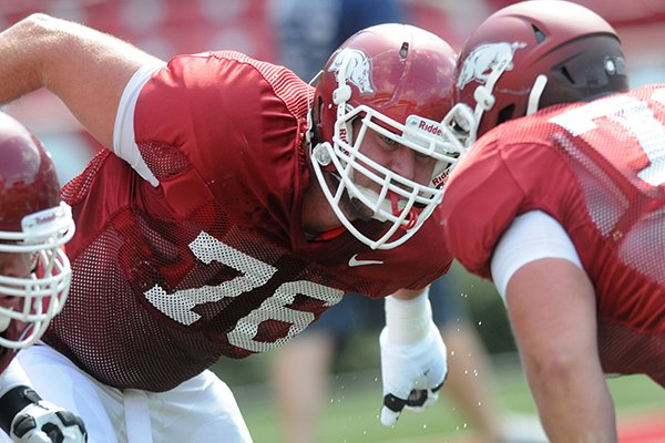 University of Arkansas lineman Dan Skipper runs drills before Saturday afternoons scrimmage at Razorback Stadium in Fayetteville.