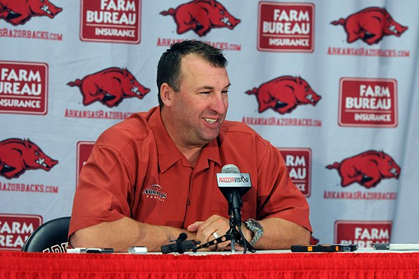 Bret Bielema, head football coach for the University of Arkansas, at a press conference during media day Sunday, Aug. 11, 2013 at the Fred W. Smith Football Center in Fayetteville.
