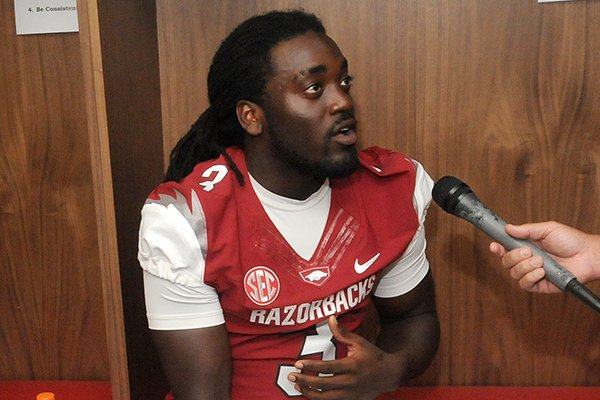 Arkansas running back Alex Collins speaks with reporters during the Razorbacks' media day.
