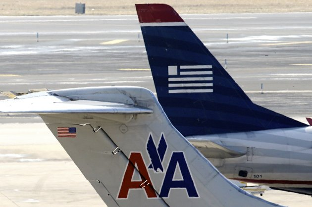american-airlines-and-us-airways-jets-prepare-for-flight-at-a-gate-at-the-philadelphia-international-airport-in-philadelphia-in-this-thursday-feb-14-2013-file-photo