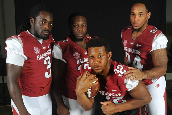 University of Arkansas running backs (left to right) Alex Collins, Kiero Small, Jonathan Williams, and Kody Walker.