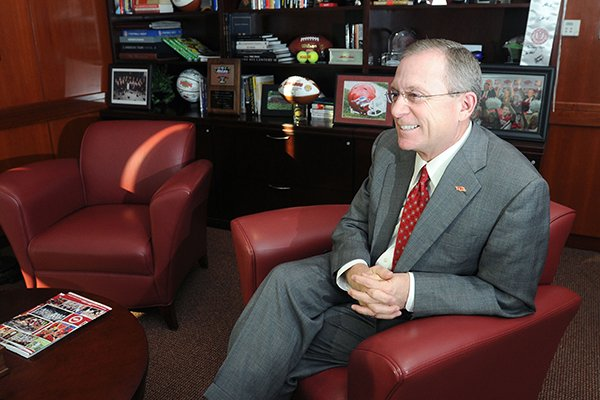 Jeff Long, athletic director for the University of Arkansas, talks to a reporter Friday, Dec. 21, 2012, in his office at the Frank Broyles Athletic Center in Fayetteville.