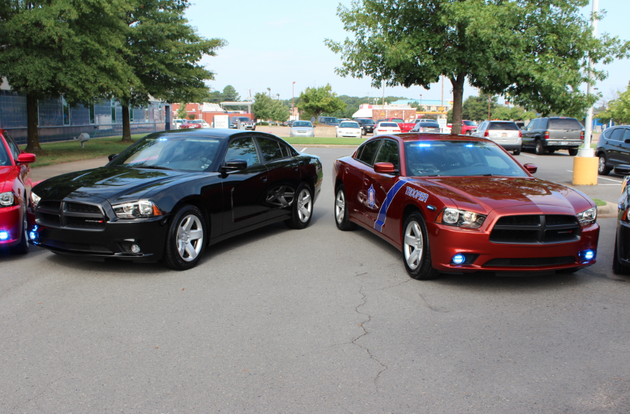 two-of-the-new-arkansas-state-police-low-profile-vehicles-are-displayed-wednesday-outside-the-agencys-headquarters-in-little-rock