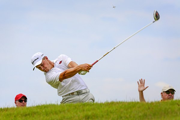 Arkansas Razorback Sebastian Cappelen tees off of second hole during a playoff in his match play against Robby Shelton during the Western Amateur at the Alotian Club in Roland.