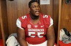 Arkansas offensive guard Denver Kirkland talks with reporters Sunday, Aug. 11, 2013 during media day in Fayetteville.