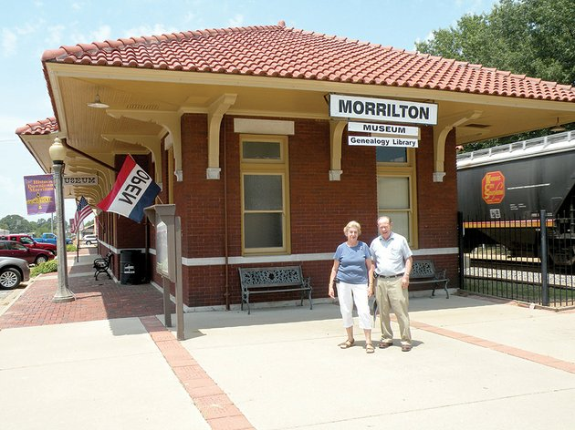 dorothy-and-carl-imhauser-stand-in-front-of-the-morrilton-depot-museum-and-genealogy-research-library-the-museum-is-open-from-10-am-to-2-pm-fridays-and-saturdays-and-by-special-appointment
