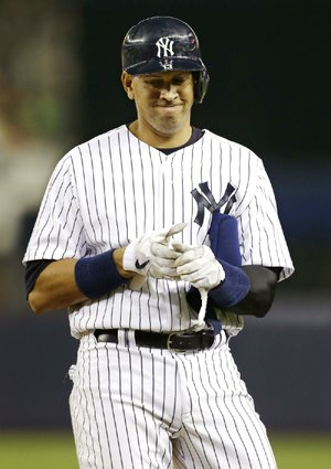 New York Yankees third baseman Alex Rodriguez  reacts after grounding into a sixth-inning double play in a baseball game against the Los Angeles Angels Monday, Aug. 12, 2013, in New York. (AP Photo/Kathy Willens)