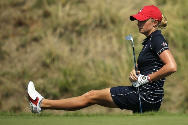 United States'  Stacy Lewis reacts to her shot from the rough on the 16th hole during a foursome match in the Solheim Cup golf tournament, Friday, Aug. 16, 2013, in Parker, Colo. (AP Photo/Chris Carlson)