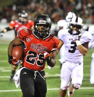 Arkansas State running back David Oku runs for a 6 yard touchdown during the 3rd quarter of the Red Wolves 45-23 victory over ULM at Liberty Bank stadium Thursday night in Jonesboro.