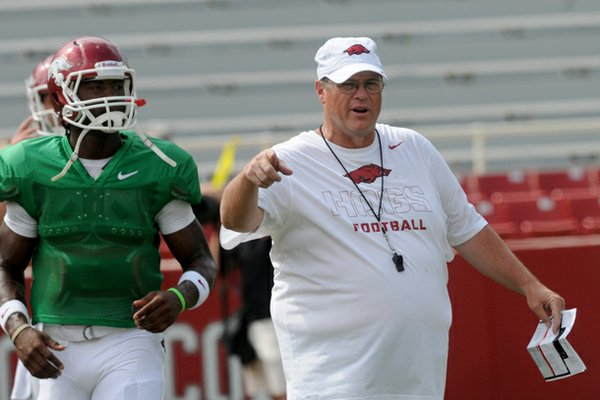 Arkansas offensive coordinator Jim Chaney watches the team warm up before Saturday's scrimmage at Donald W. Reynolds Razorback Stadium in Fayetteville.