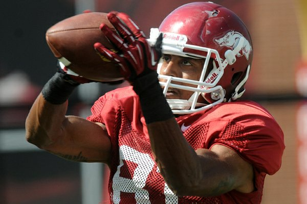 Arkansas wide receiver Demetrius Wilson warms up at the first fall scrimmage at Donald W. Reynolds Razorback Stadium in Fayetteville. Arkansas coach Bret Bielema announced the senior wide receiver tore his ACL.