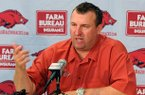 Arkansas coach Bret Bielema speaks at a press conference during media day Sunday, Aug. 11, 2013 at the Fred W. Smith Football Center in Fayetteville.