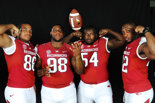 Arkansas defenders (left to right) Trey Flowers, Robert Thomas, Bryan Jones, and Chris Smith