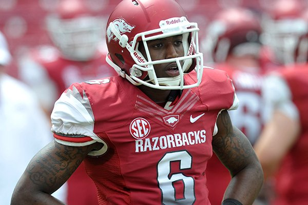 Arkansas receiver D'Arthur Cowan watches warmups prior to the Razorbacks' Red-White game on April 20, 2013 in Fayetteville.