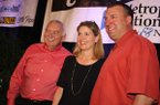 Gary Underwood of Bigelow, Anne Jansen Broadwater and UA coach Bret Bielema at the Little Rock Touchdown Club on Wednesday, Aug. 21, 2013.