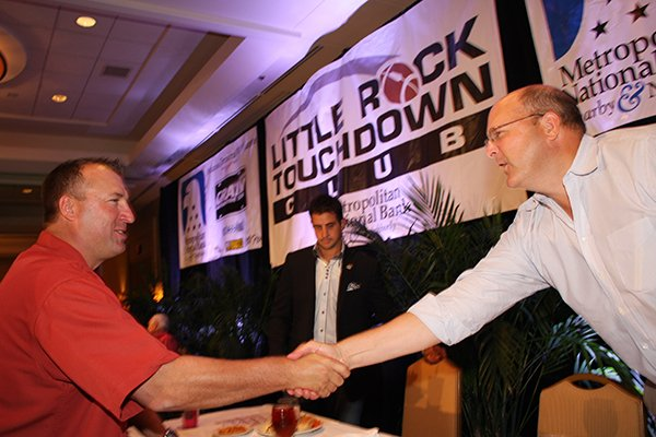 Arkansas coach Bret Bielema shakes the hand of a fan at the Little Rock Touchdown Club on Wednesday, Aug. 21, 2013.