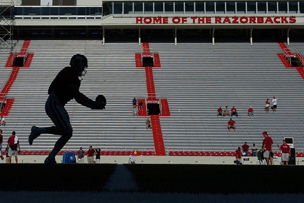 A player runs drills at Razorback Stadium in Fayetteville.