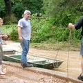 Cameron McNabb, center, and his daughter, Kayna, were rescued during Thursdays flooding. Co-worker C...