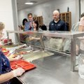 Teacher Carolyn Armour and Jeff Neil, Arvest Bank president, were served breakfast at Pea Ridge Midd...