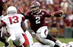 Texas A&M quarterback Johnny Manziel scrambles through the Arkansas defense during the second quarter on Saturday, Sept. 29, 2012, at Kyle Field in College Station, Texas.