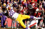 LSU wide receiver Jarvis Landry makes a catch for a touchdown in front of Arkansas linebacker Otha Peters during the second quarter on Friday, Nov. 23, 2012, at Donald W. Reynolds Razorback Stadium in Fayetteville.