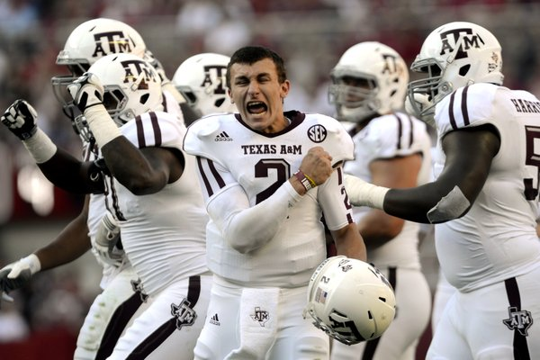 Texas A&M quarterback Johnny Manziel (2) celebrates after a review proves an Aggie touchdown during the first half of their first SEC meeting against and Alabama in an NCAA college football game, Saturday, Nov. 10 in Tuscaloosa, Ala. No. 15 Texas A&M defeated No. 1 Alabama 29-24.