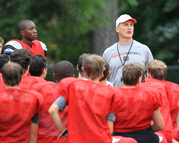 roddy-mote-head-coach-of-the-defending-3a-state-champion-harding-academy-wildcats-talks-with-his-players-during-fall-practice-fourteen-seniors-return-to-the-field-for-the-2013-season