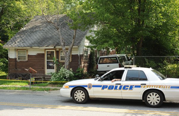 a-fayetteville-police-officer-sits-in-a-police-vehicle-thursday-aug-22-2013-outside-a-house-at-510-s-college-ave-a-day-after-a-woman-was-found-dead-in-the-residence