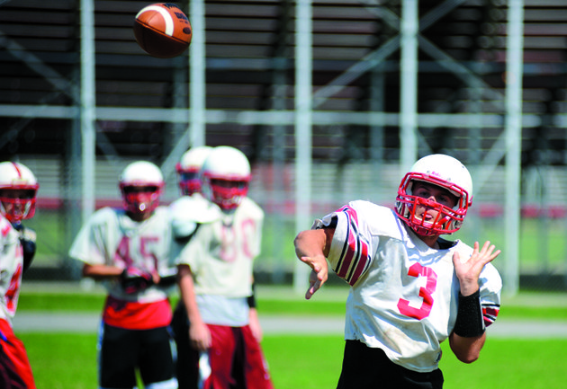 atkins-quarterback-alex-spradlin-sends-the-ball-downfield-during-preseason-practice
