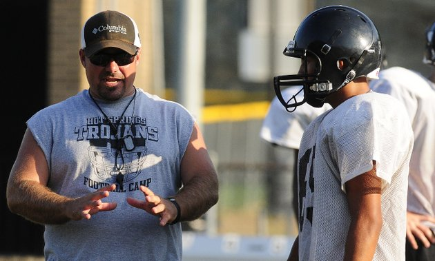 hot-springs-head-coach-chris-vereen-talks-with-players-during-a-preseason-practice-at-the-high-school
